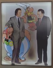 Goscinny y Uderzo con sus personajes, en un afiche infaltable.